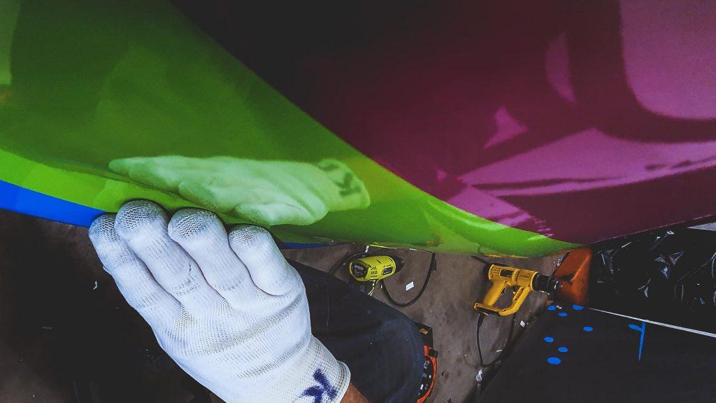 Portfolio - Osmond Ergonomics Close up Detailed Inspection of Van Wrap - Insignia Signs
