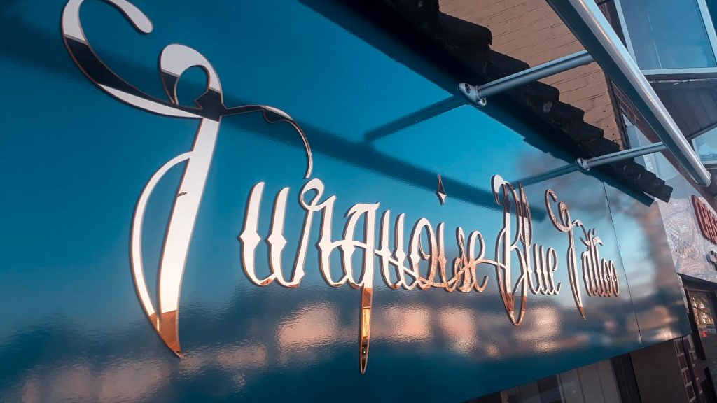 Portfolio - Turquoise Blue Tattoo Shop Sign Side View - Insignia Signs Poole & Bournemouth